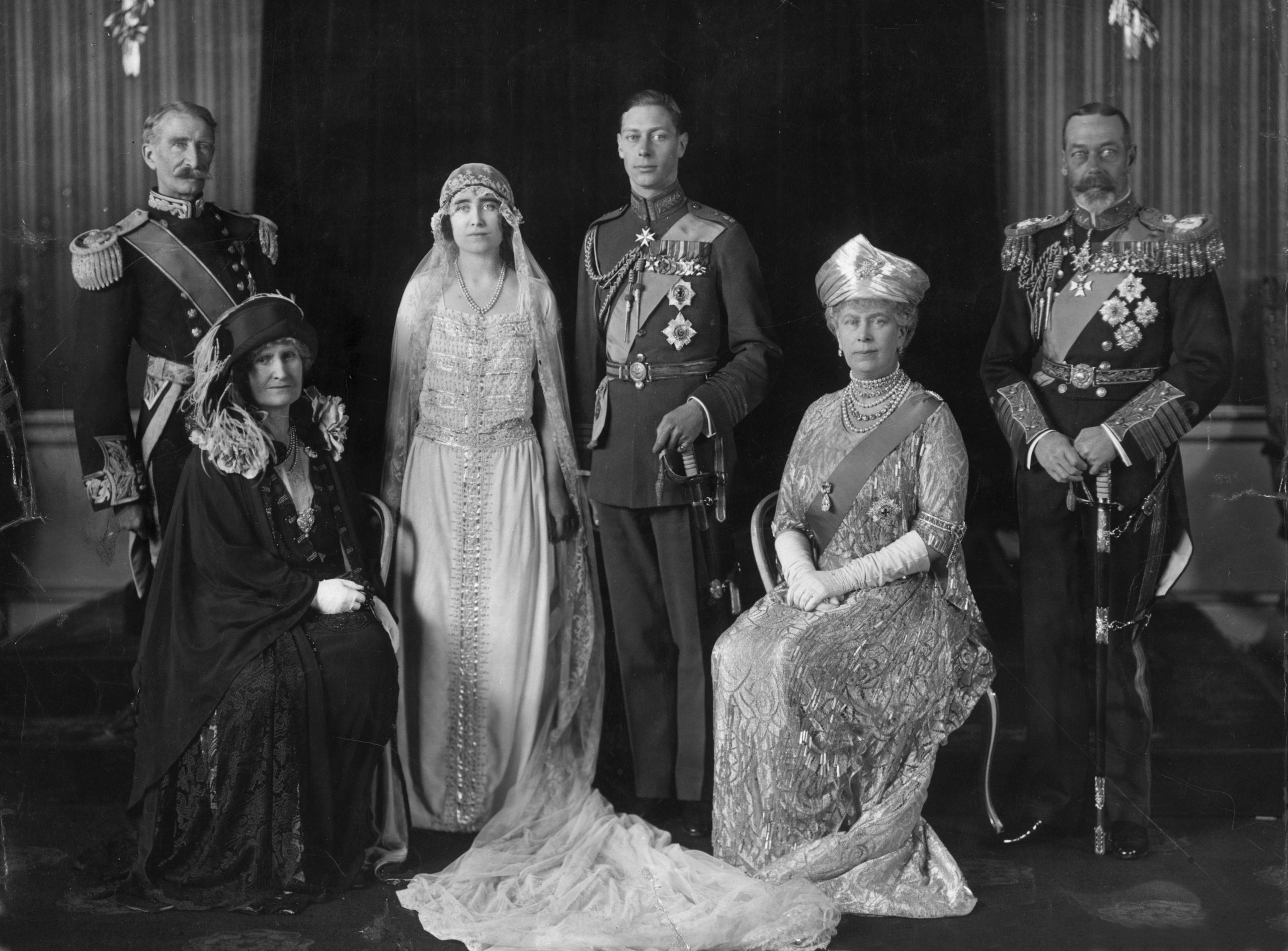26th April 1923:  King George V of Great Britain (right) and Queen Mary on the wedding day of their son George, later King George VI, to Elizabeth Bowes-Lyon (1900 - 2002). With them are the Earl and Countess of Strathmore (left)